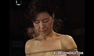 Asian playgirl in rope slavery scene