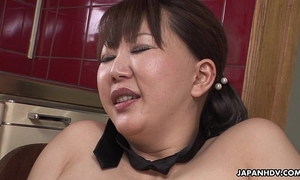 Chubby japanese milf groans during the time that her curly love tunnel is toyed