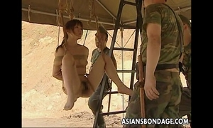 Asian doxy hanging on some ropes screwed by the soldiers